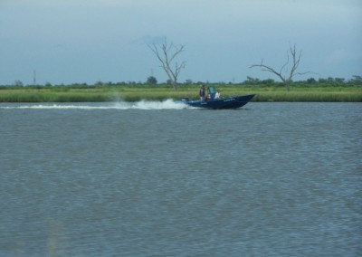 This is a skiff similar to the ones mentioned in the book. He's in a hurry!